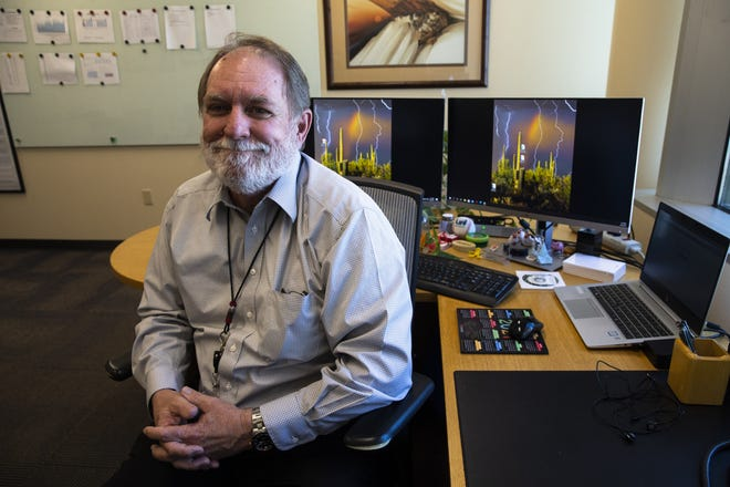 Newly appointed interim director of the Arizona Department of Health Services, Don Herrington, at work in his office in Phoenix on Aug. 26, 2021.