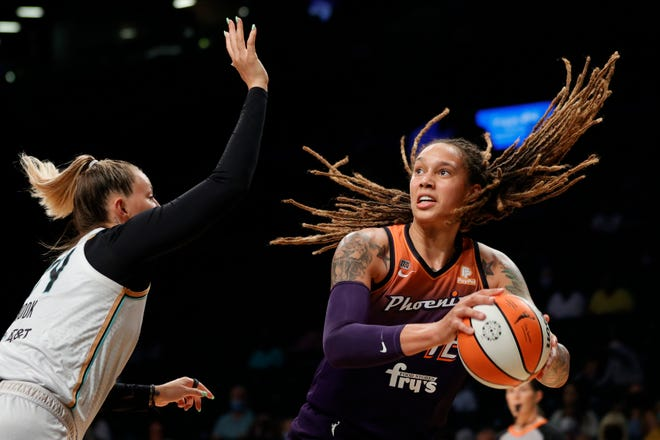 NEW YORK, NEW YORK - AUGUST 25: Brittney Griner #42 of the Phoenix Mercury dribbles as Kylee Shook #24 of the New York Liberty defends during the second half at Barclays Center on August 25, 2021 in the Brooklyn borough of New York City. The Mercury won 106-79.