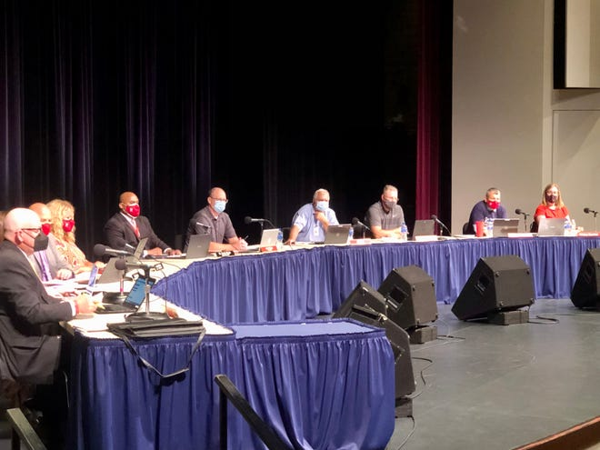 Richmond Community School Board members listen to public comments for and against the district's mask mandate at board meeting on Wednesday, Aug. 25, 2021.