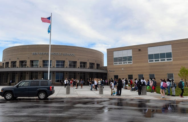Students arrive for the first day of school on Thursday, August 26, 2021 at the new Ben Reifel Middle School in Sioux Falls.
