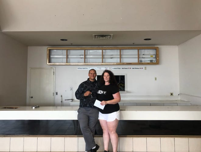 Lawrence and Sophie West stand in front of their future food court location of Watecha Bowl to open January 2022 at the Sunset Plaza Mall in Norfolk, Nebraska