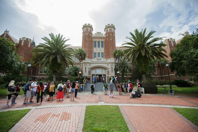 Florida State University Graduate Assistants United and supporters gather outside Ruby Diamond Auditorium to demand that FSU enforce face masks to protect the graduate assistants as well as faculty, staff, and students Thursday, Aug. 26, 2021.