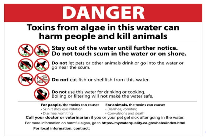State and local officials are warning people and their petsto stay out of Hensely Lake in Madera County because of potentially toxic algae.