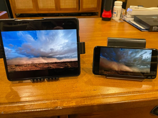 You can watch videos on the Samsung Galaxy Z Fold3 5G ($1,799.99, available now), shown next to a Google Pixel 5 for comparison.
