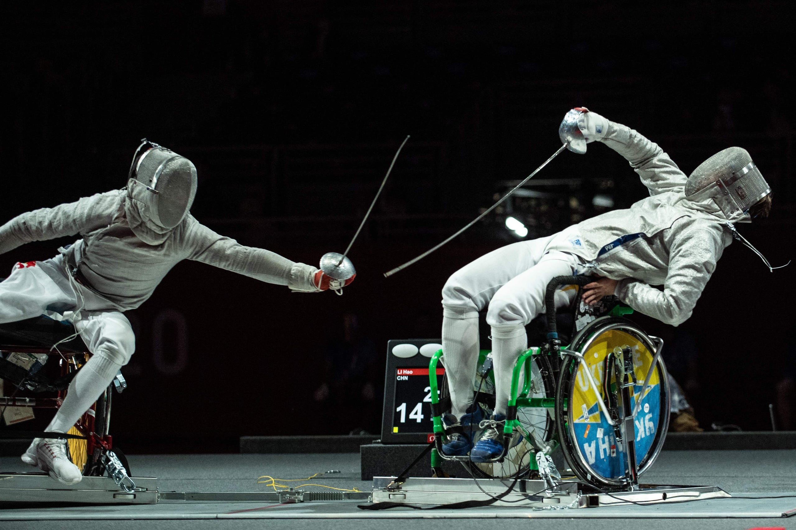 August 25, 2021: China's Li Hao (L) competes with Ukraine's Artem Manko during the men's sabre individual category A gold medal wheelchair fencing bout at the Tokyo 2020 Paralympic Games at the Makuhari Messe Hall in Chiba.