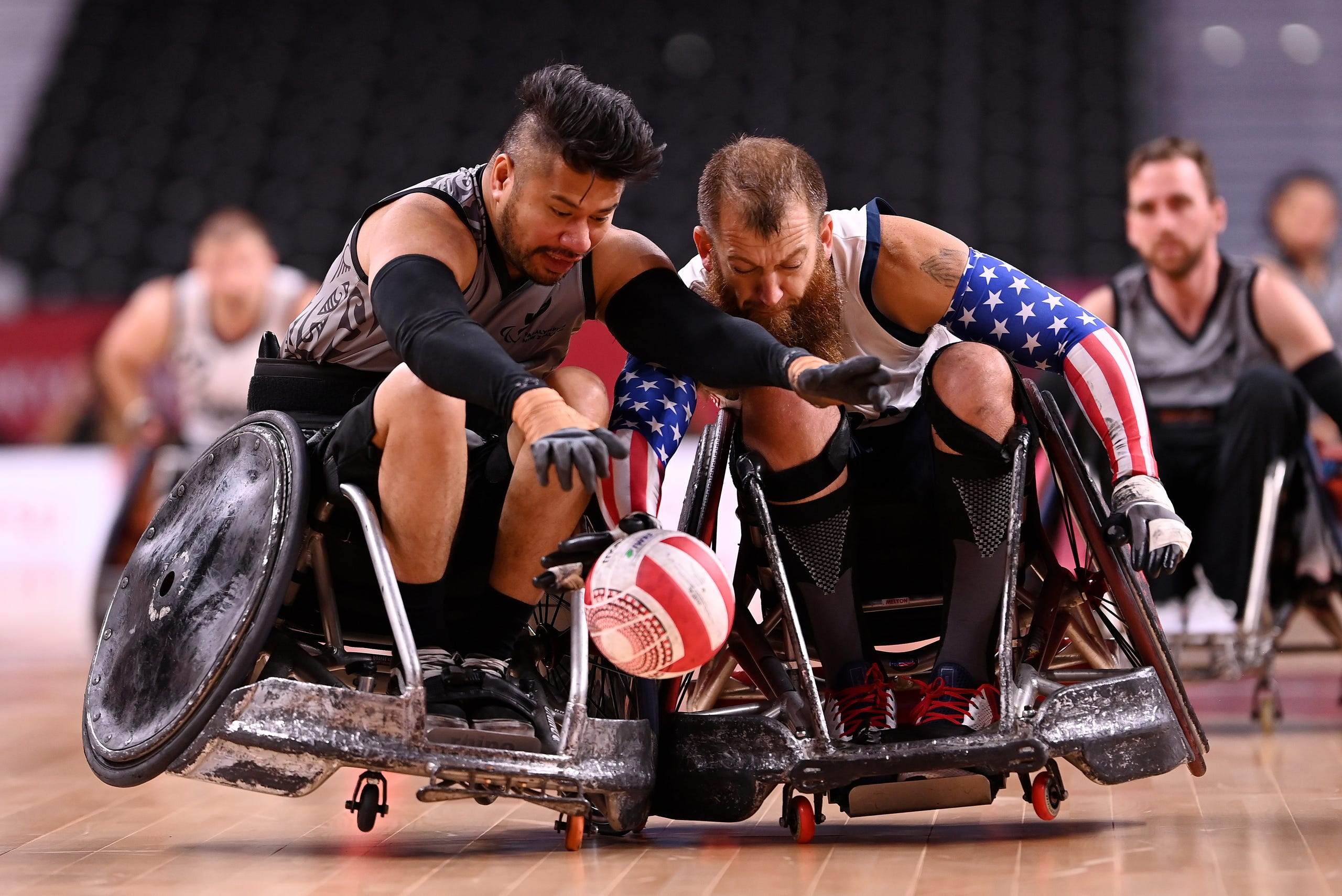 August 25, 2021: Tainafi Lefono of Team New Zealand is tackled by Charles Melton of Team United States during the Wheelchair Rugby Pool Phase Group B match between Team United States and Team New Zealand on day 1 of the Tokyo 2020 Paralympic Games at Yoyogi National Stadium in Tokyo, Japan.