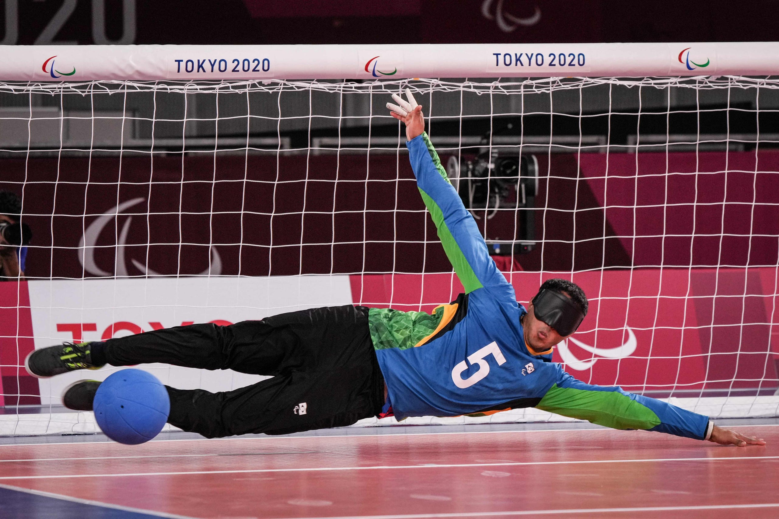 August 26, 2021: Brazil's Josemarcio Sousa dives to defend during the goalball preliminary group A match against USA at the Tokyo 2020 Paralympic Games at Makuhari Messe Hall in Tokyo.