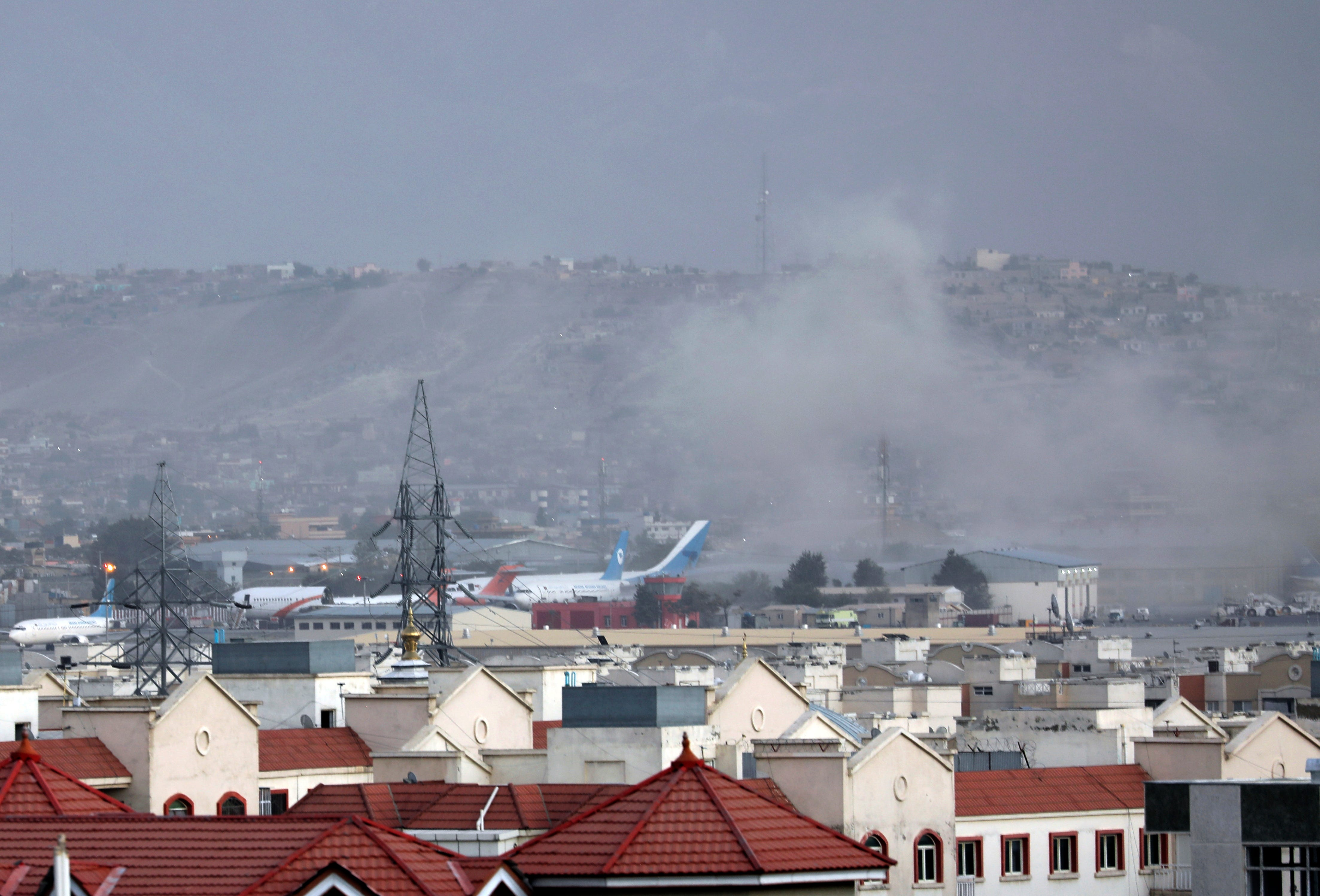 Desperate crowds, closed gates, people stranded after bombing at Kabul airport