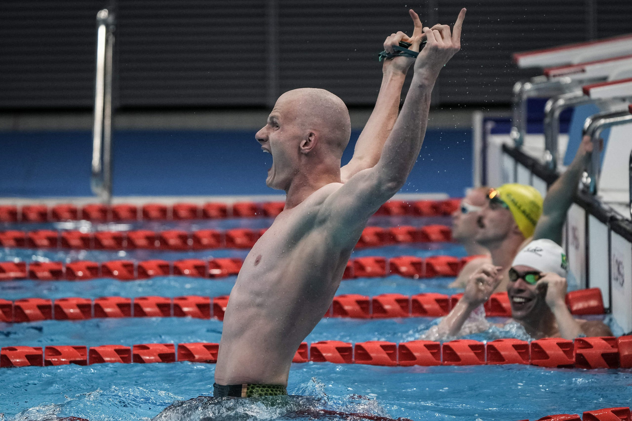 August 25, 2021: Australia's Rowan Crothers (L) reacts after winning the final of men's 50m freestyle (S10) at the Tokyo 2020 Paralympic Games at Tokyo Aquatics Centre in Tokyo.
