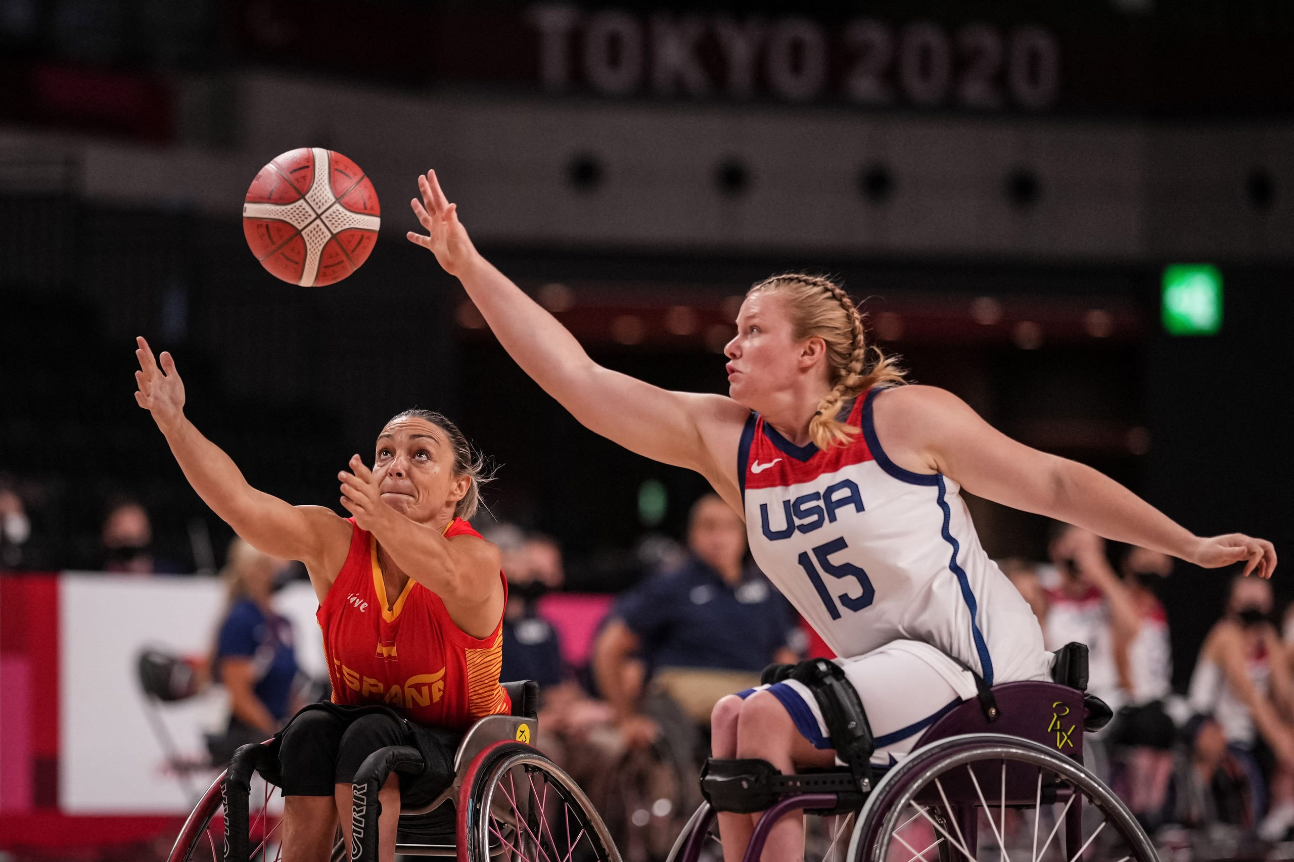 August 26, 2021: Spain's Sonia Ruiz Escribano (L) and USA's Rose Hollermann reach for the ball during the women's wheelchair basketball preliminary round group B match between USA and Spain at the Tokyo 2020 Paralympic Games at Ariake Arena in Tokyo.