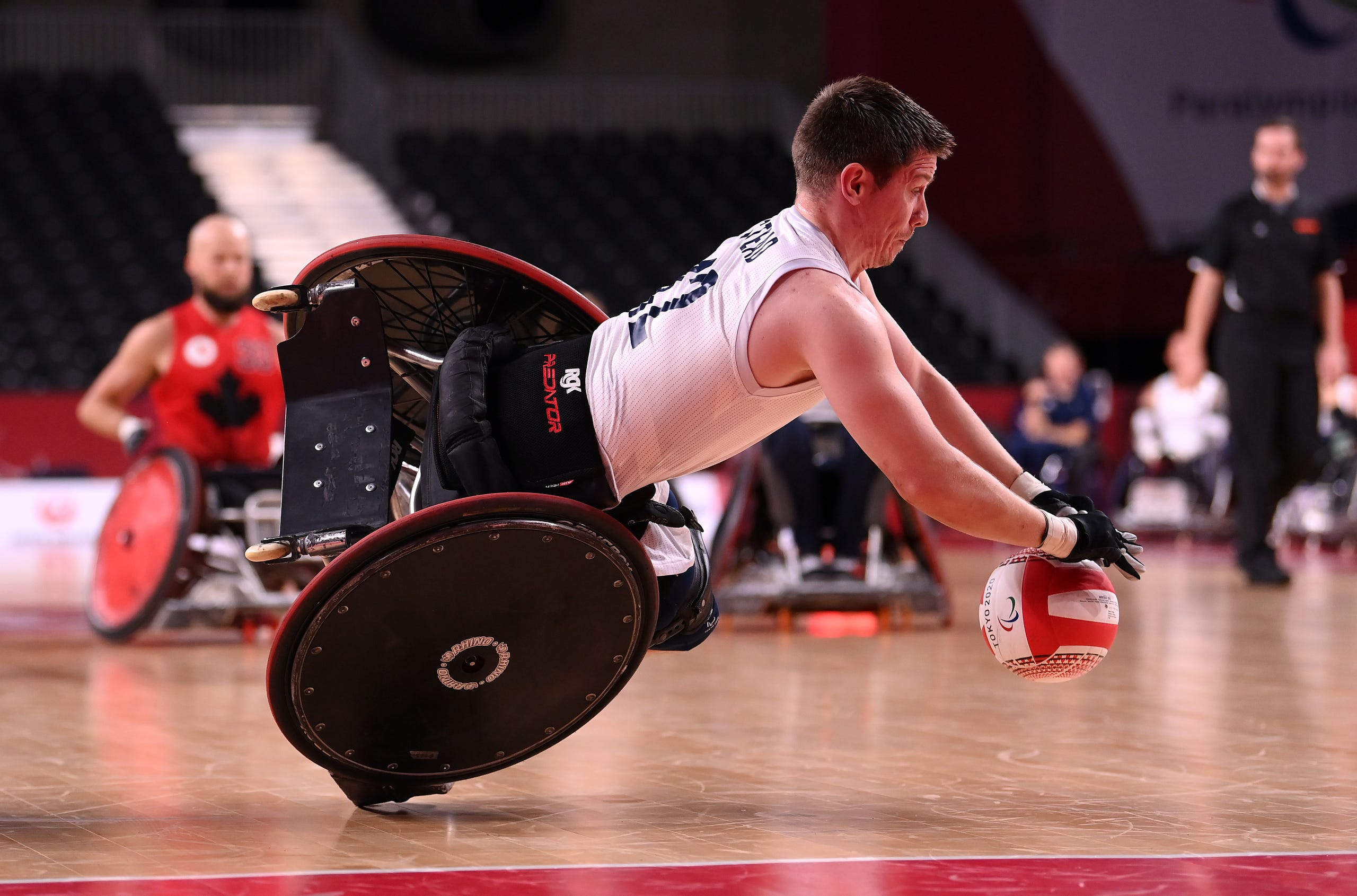 August 25, 2021: Jamie Stead of Team Great Britain falls to the floor after being tackled by Cody Caldwell of Team Canada during the Wheelchair Rugby Pool Phase Group match between Team Great Britain and Team Canada on day 1 of the Tokyo 2020 Paralympic Games at Yoyogi National Stadium  in Tokyo, Japan.