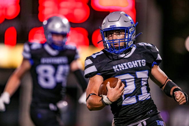 McCallum running back Colby Napier, running against Anderson in the season opener, said beating the Trojans is his biggest football thrill. He did not join the football team until he was a junior because he concentrated on soccer.