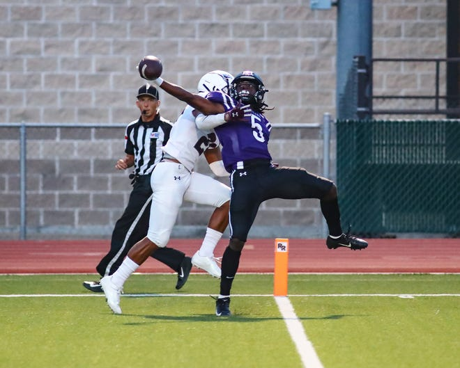 Vincent Taylor Jr. hauls in the one-handed touchdown for Cedar Ridge against the Killeen Kangaroos on Aug. 26 in nondistrict action at Dragon Stadium. Quick-strike touchdowns on either side of a lightning delay sparked Cedar Ridge to a 45-14 season-opening win.