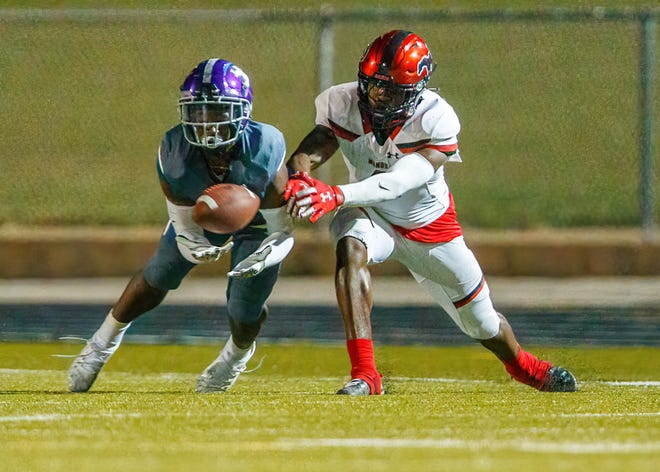 LBJ defensive back Syrallin Gilliam intercepts a pass intended for Manor wide receiver Ikechukwu Esonwune during the third quarter Thursday. Gilliam and Noah Baker each had an interception for LBJ, which also recovered three fumbles.