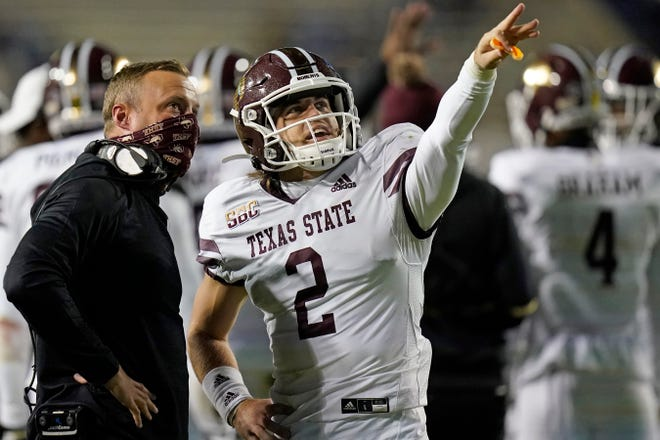 Texas State quarterback Brady McBride, right, was one of coach Jake Spavital's first transfer players, coming from Memphis in 2019. Spavital, left, has transformed his roster through heavy use of the NCAA transfer portal. There has been an 85% turnover from the roster he inherited two years ago.