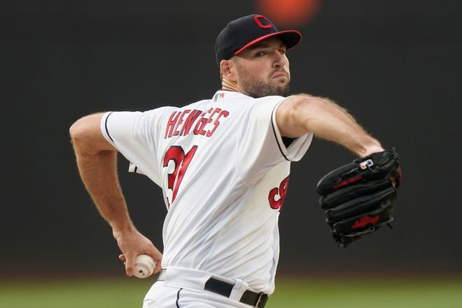 Cleveland starting pitcher Sam Hentges winds up during the first inning of the team's baseball game against the Texas Rangers, Thursday, Aug. 26, 2021, in Cleveland. (AP Photo/Tony Dejak)
