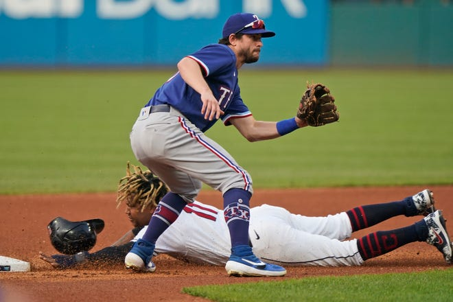 Cleveland's Jose Ramirez steals second as Texas Rangers' Nick Solak waits for the throw during the first inning of a baseball game, Thursday, Aug. 26, 2021, in Cleveland. (AP Photo/Tony Dejak)
