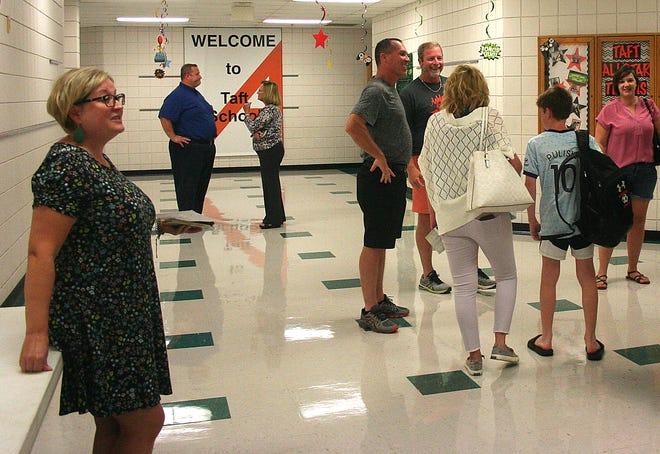 Heather Olsen, left, school-based therapist, greets families visiting Taft Intermediate's open house for fifth-graders Thursday, Aug. 26, 2021.  LIZ A. HOSFELD/FOR TIMES-GAZETTE.COM