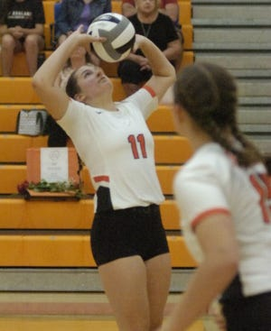 Ashland High School's Jenna Hartson (11) sets during volleyball action between Madison and Ashland at Arrow Arena Thursday, Aug. 26, 2021.