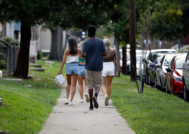 Ohio State off-campus students enjoy an early start to their first weekend on campus after classes on Aug. 26.