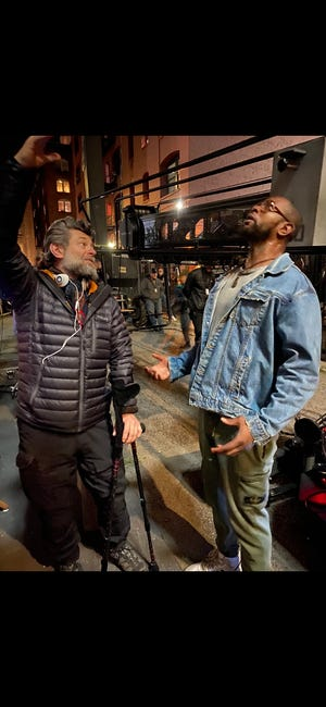 """Otis Winston receives instruction from director Andy Serkis for a scene in the movie """"Venom: Let There Be Carnage."""""""