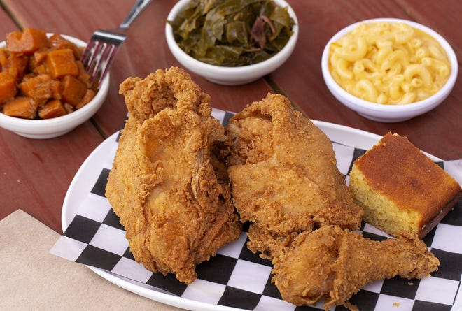 Fried chicken dinner with greens, mac-and-cheese and yams at Modern Southern Table in the Budd Dairy Food Hall