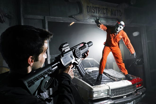 Nick Francis, left, is an owner of Nightmare Combat, which offers a horror laser tag experience for players. Zachary Hubler, right, portrays a cyborg monster.