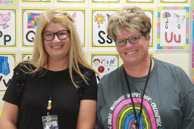 First grade teacher Kim Fuchs and Intervention specialist Jenny Legats share 53 years of experience in the East Guernsey School District