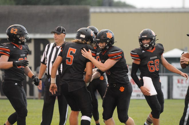 Hudson's Easten Strodman (5) and Brendan Akers celebrate a touchdown during Thursday's game against Ithaca.