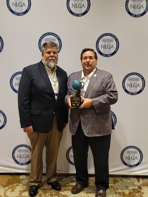 Louisiana Lt. Gov. Billy Nungesser, right, receives the 2021 Recycling Impact Award.