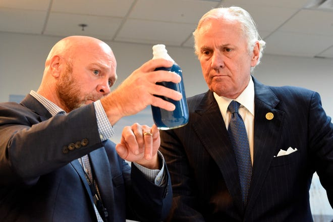 South Carolina Gov. Henry McMaster, right, listens as Foster Jordan of Charles River Labs, left, talks about the properties of horseshoe crab blood, which is a vital component in the contamination testing of injectable medicines - including the coronavirus vaccines - at Charles River Labs on Friday, Aug. 6, 2021, in Charleston, S.C.