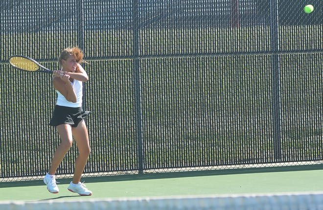McPherson player Taylor Berger competes at first singles at the Hesston Invitational. Berger finished third in the flight. McPherson won the tournament title.