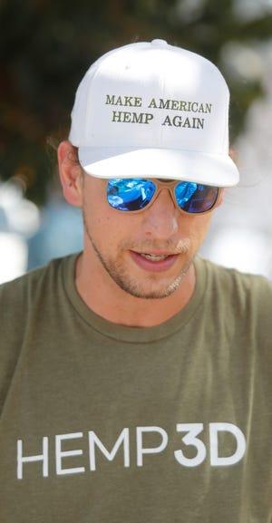 Joe Naumana, Managing Partner of Hemp Vision, talks about the hemp sunglasses frames.  The Texas Hemp Growers Association hosted Thursday the 26th. (Mark Rogers / For AJ Media)