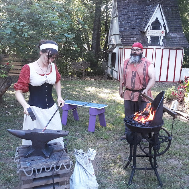 Members of the Institute for Historic and Educational Arts perform blacksmithing at the Kansas City Renaissance Festival.