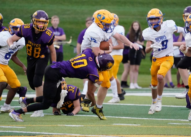 Caden Pridemore of Jefferson escapes a tackle on the way to a punt-return touchdown against Onsted Thursday night.