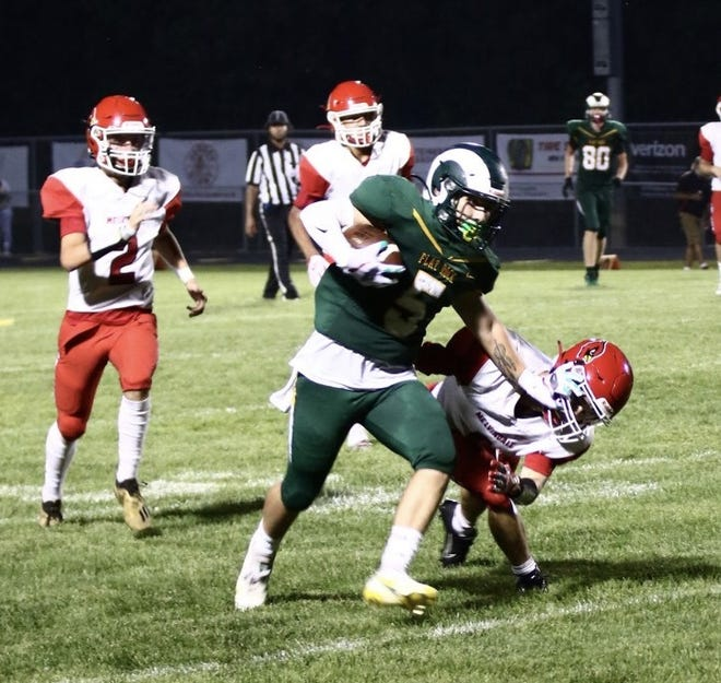 Flat Rock's Zach Moosekian breaks a tackle on the way to a 56-yard touchdown Thursday night. The Rams, who were winless last season, opened with a 34-6 victory over Melvindale.
