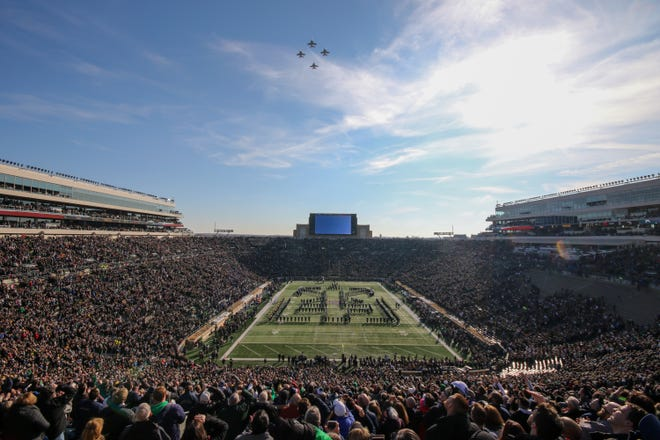 Four military jets perform a flyover before the Notre Dame-Navy football game Saturday, Nov. 16, 2019, at Notre Dame Stadium in South Bend. The school will return to full capacity Sept. 11 for the first time since the 2019 season.