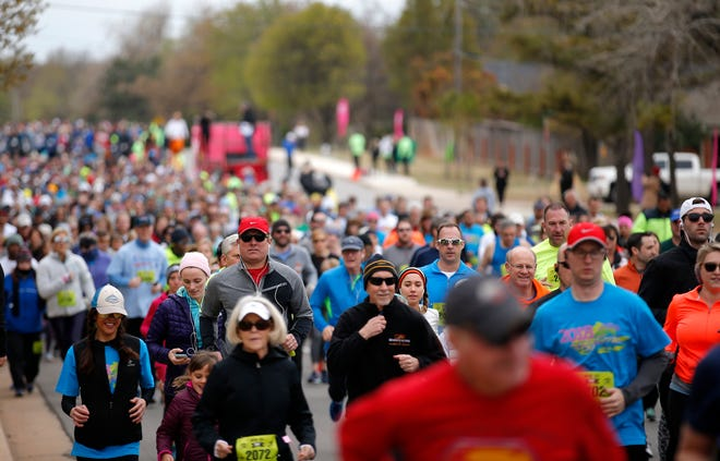 People run in the 5k during the Redbud Classic in Oklahoma City in 2018. After being postponed this year until September, the 2021 Redbud Classic was canceled Friday because of rising COVID-19 numbers.