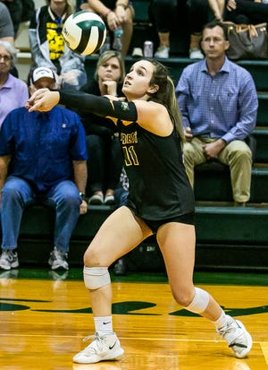 Forest #11 Mackenzie Danner sets the ball for teammates. Forest hosted Venice Thursday night, August 26, 2021 in Ocala, FL. Forest beat Venice in the first set 29-27. [Doug Engle/Ocala Star Banner]2021