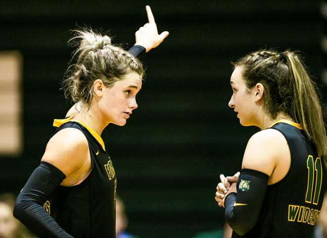 Forest's Emma Truluck talks with teammate Mackenzie Danner during a match last month against Venice.