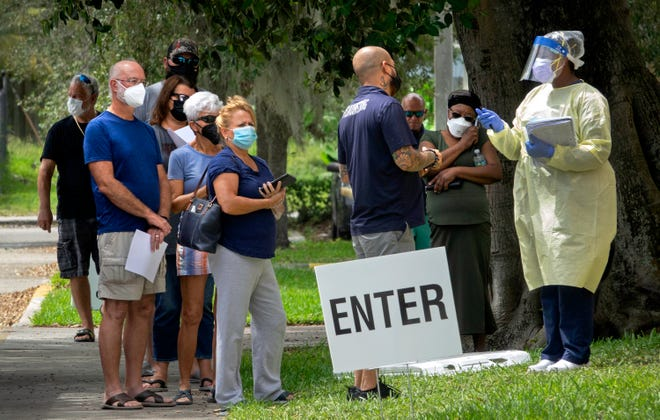 People line up for Regeneron treatments at Westgate Park in West Palm Beach Wednesday, Aug. 25, 2021. The monoclonal antibody therapy has shown signs it can help patients avoid severe symptoms if it is started shortly after an infection.