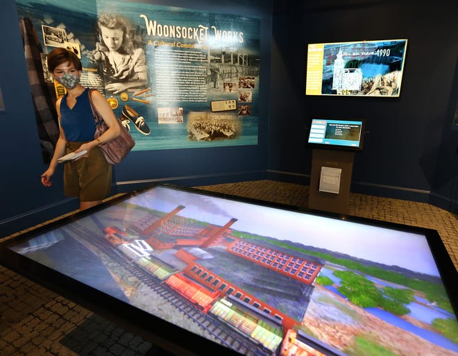 Amy Russo looks over the new interactive mill exhibit at The Museum of Work & Culture, in Woonsocket.