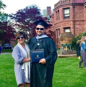 Sgt. Adam DeCiccio with his mother, Dawn, at his 2019 graduation from Salve Regina University, where was the keynote speaker.