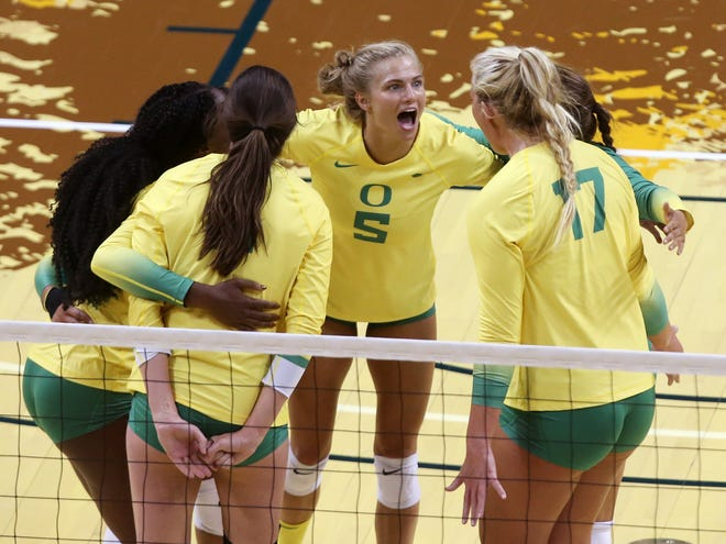 Oregon's Brooke Nuneviller, center, and the Ducks celebrate a point during their match against Portland State at the Oregon Invitational in August.