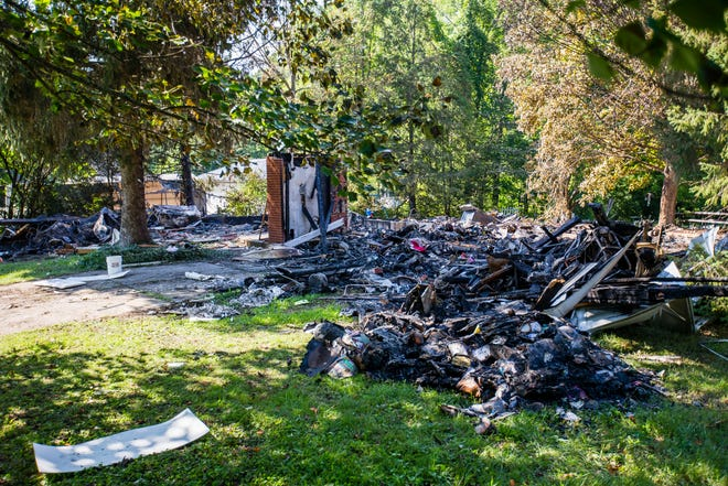 A small brick wall and ruble remain after explosive fire Friday on Kern Road in South Bend that killed a man.