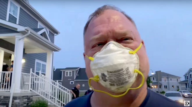 A frame from Freedom 2 Film's YouTube video shows South Bend firefighter Lance Gunderson shouting at and bumping a person who was filming police and firefighters during a call  June 13 on Duey Street near Eddy Street Commons.