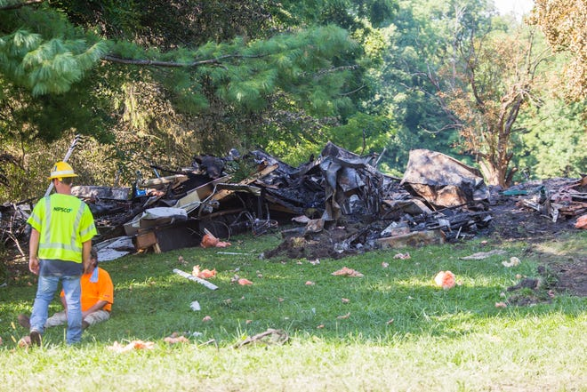 NIPSCO workers respond Friday to an explosive fire on Kern Road in South Bend that leveled a house and killed a man.
