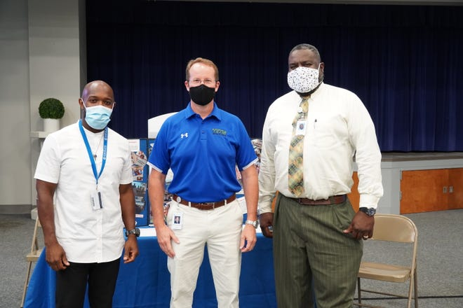 Omar Porter, Dr. Jason Hurst and Jerry Hopper are shown masked up on the campus of Cleveland Community College.