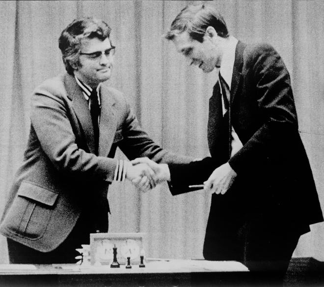 Lothar Schmid of West Germany, left, chief referee of the World Chess Championship, shakes the hand of American chess star Bobby Fischer, telling him he is the winner of the match after Boris Spassky resigned by telephone on Sept. 1, 1972, in Reykjavik, Iceland.