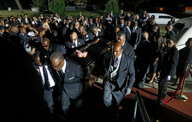 Pallbearers carry the casket of Aretha Franklin at her burial in Woodlawn Cemetery in Detroit on Aug. 31, 2018. Franklin died Aug. 16, 2018, of pancreatic cancer at the age of 76.